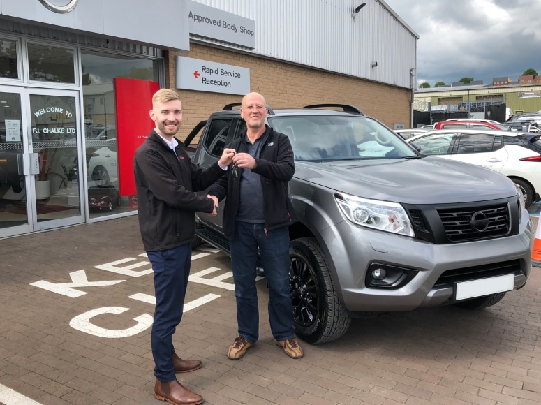 Jordan handing over new De-Chromed Navara Truck to a happy customer